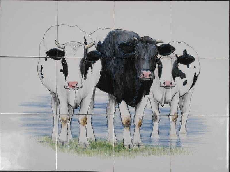 3 Kühe im Wasser
